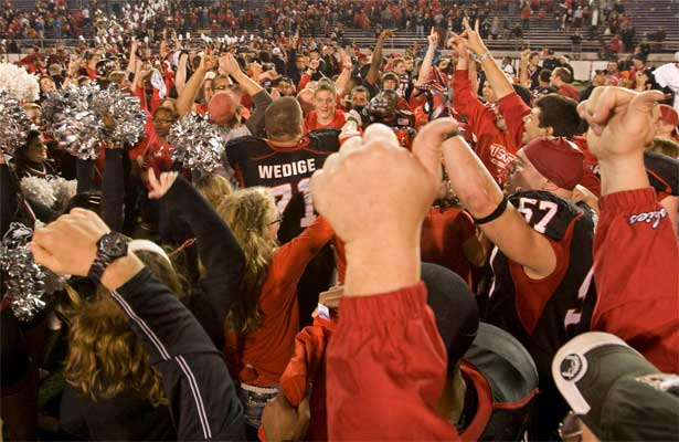NIU Huskie football players and fans celebrate the GoDaddy.com Bowl win in Mobile, Ala.