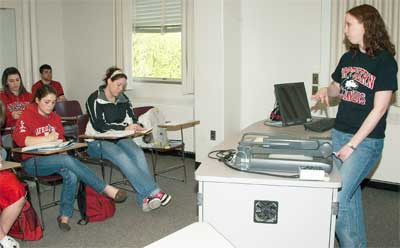 Photo of an NIU teaching assistant in front of the classroom