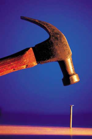 Photo of a hammer and a nail