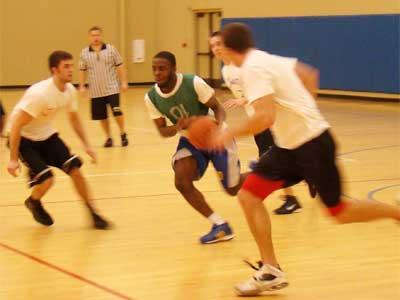 Photo of students playing basketball