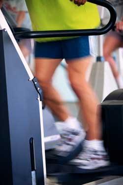 Photo of adult exercising on a elliptical machine.