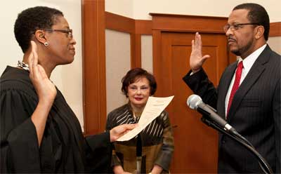 The Hon. Sharon J. Coleman, a federal judge for the Northern District of Illinois, administers the oath of office to her husband, Wheeler G. Coleman.