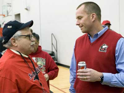 Coach Doeren chats with a Huskies fan at the 2011 HASF kickoff event.