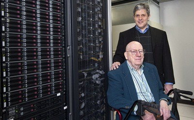 Clyde Kimball (front) and Nicholas Karonis with NIU's new computer cluster.