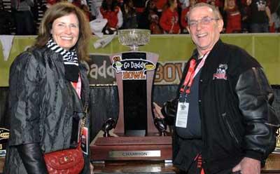 NIU Huskies fans pose with the GoDaddy.com Bowl trophy
