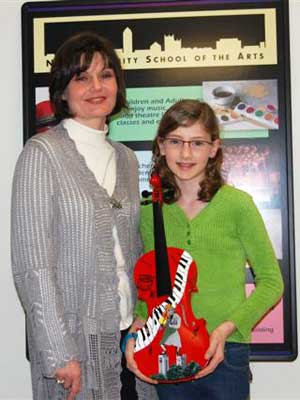 Somonauk artist Anna Kennedy and her daughter, Sophie, show the painted violin created for Performathon.