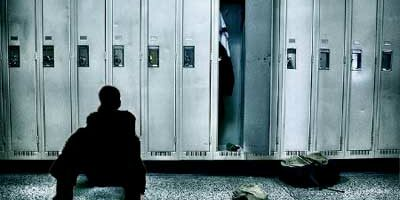 Image of silhouetted youth in front of a row of lockers