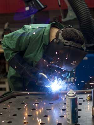 An NIU engineering student works on the NIU MotorSports Mini Baja vehicle.