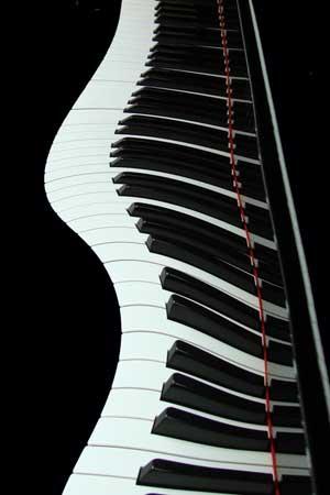 """Photo of """"wavy"""" piano keys"""