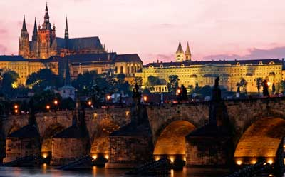 A photo of the Charles Bridge in Prague at sunset.