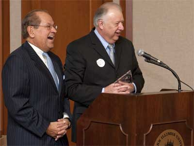 NIU President John Peters honors former Trustee Manny Sanchez during the March 1 board meeting.