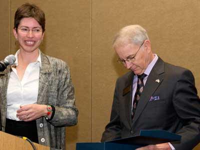 Illinois Lt. Gov. Shelia Simon gives the Illinois Rural Champion Lifetime Achievement Award to NIU's Normal Walzer.