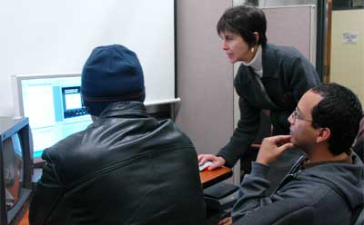 Laura Vaquez works with students in the editing suite.