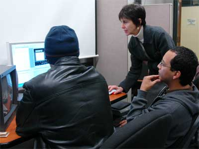 Laura Vazquez works with students in the editing suite.