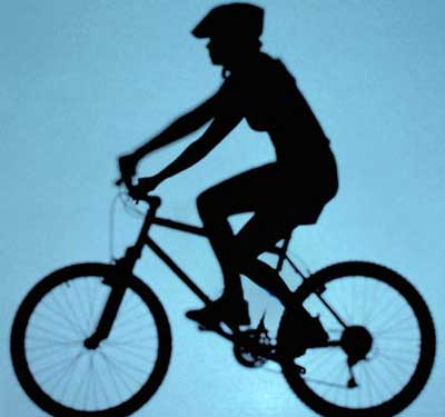 Silhouetted image of a bicycle rider