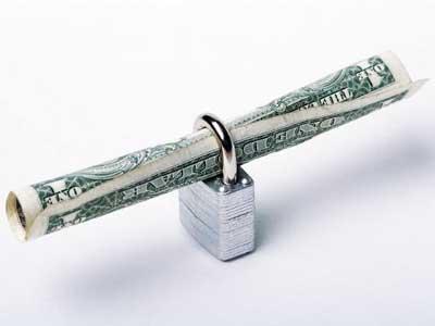 Photo of a dollar bill inside a lock