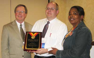 From left: Richard Deming, international president of Phi Beta Delta; NIU's J.D. Bowers; and Yvonne Captain, former executive director of Phi Beta Delta.