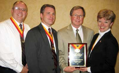 NIU received the Eileen Evans Overall Outstanding Chapter Award, signifying the strongest contributions to international education by a Phi Beta Delta Chapter over the preceding year. From left: J.D. Bowers; Christopher M. Jones, past president of Zeta Gamma Chapter; International President Richard Deming; and Deborah Pierce, chapter coordinator.