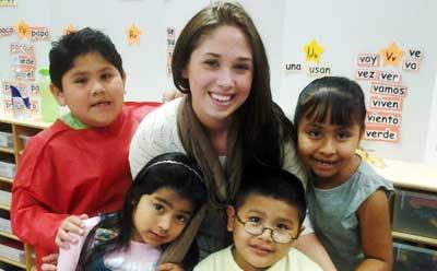 DeKalb schoolchildren surround Project ROAR tutor Allyce Leafbland.