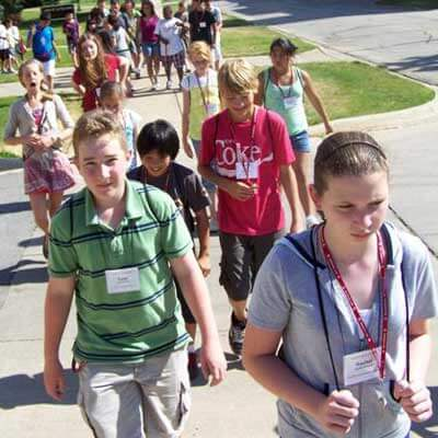 Summer campers walk north on Normal Road.