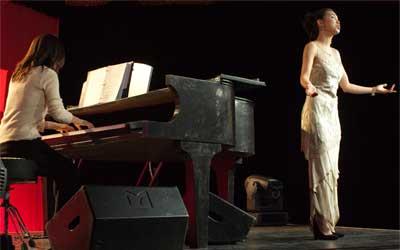 Moonja Jeong sings at the 2012 Red and Black.
