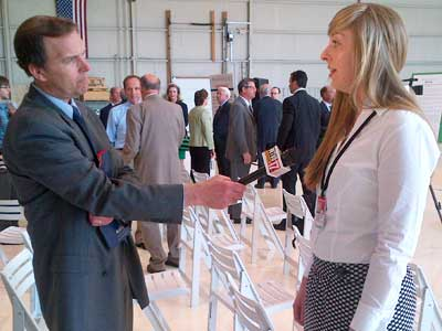 Laura Gallagher, an NIU student and intern at Hamilton-Sundstrand in Rockford, is interviewed by WTVO-Channel 17 reporter Bob Ryder after the news conference.