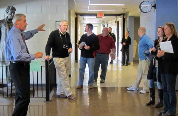 Sycamore Superintendent Wayne Riesen leads a tour of North Grove Elementary School.