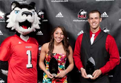 Victor E. Huskie with Newcomer of the Year winners Amanda Corral and Jeff Zimmerman.