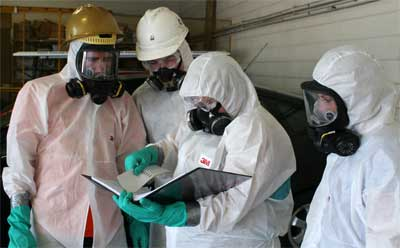 Mike Sherry, Eric Madden, Rachael Hines and Sarah Brokus discuss a plan of action before entering a simulated contamination site.