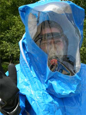 Briana O'Halleran learns to use self-contained breathing apparatus and protective suit.