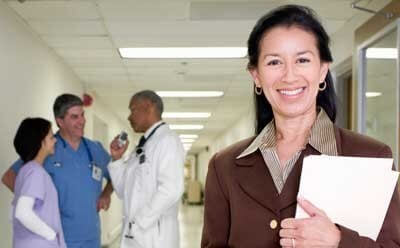 Stock image of a public health worker in a hospital hallway