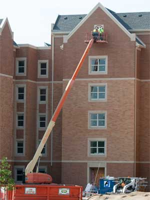 Workers are busy completing NIU's new residential complex, which opens this fall.