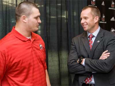 Schepler chats with NIU head football coach Dave Doeren.