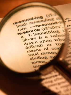 "Photo of a magnifying glass over the word ""resource"" in the dictionary"