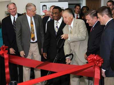 NIU President John Peters leads the ribbon-cutting Monday at NIU's new residence hall.