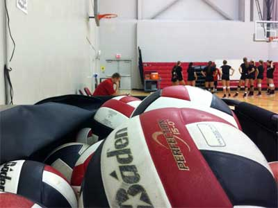 A pile of volleyballs await the NIU Huskies