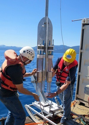 Reed Scherer (left) and Ross Powell prepare to test a coring device at Lake Tahoe.