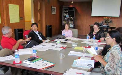 CTP faculty fellows talk during an Aug. 20 retreat.