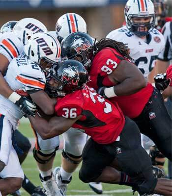 Huskie defenders Tyrone Clark (36) and Ken Bishop (93)