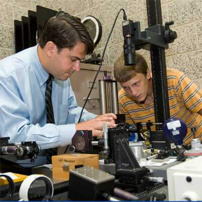 Sciammarella works with an NIU mechanical engineering student.