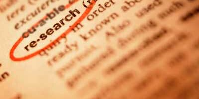 """Photo of the word """"research"""" circled in the dictionary"""