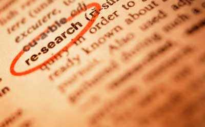 "Photo of the word ""research"" circled in the dictionary"