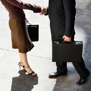 Photo of a businesswoman and businessman shaking hands