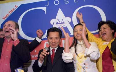 "Anh ""Joseph"" Cao, center, celebrates his election in 2008. (New Orleans Times-Picayune photo)"