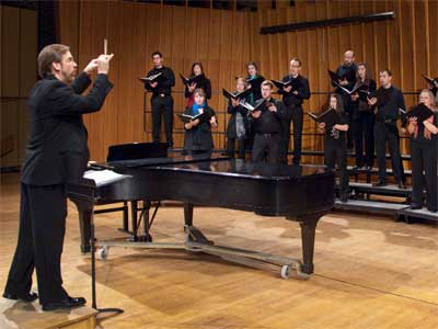 Eric Johnson conducts NIU choral students.