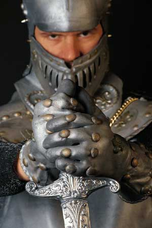 Photo of a knight in armor holding a sword