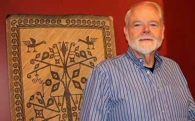 """Professor emeritus and exhibit curator Richard Cooler with some of the objects on display at """"Rarely Seen Southeast Asia,"""" opening Oct. 11 at The Anthropology Museum in Fay-Cooper Cole Hall."""
