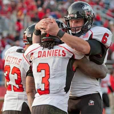 Jordan Lynch (6), Akeem Daniels (3) and Leighton Settle (23) celebrate a touchdown in Muncie.