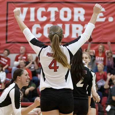 Meghan Romo (4) raises her arms in victory