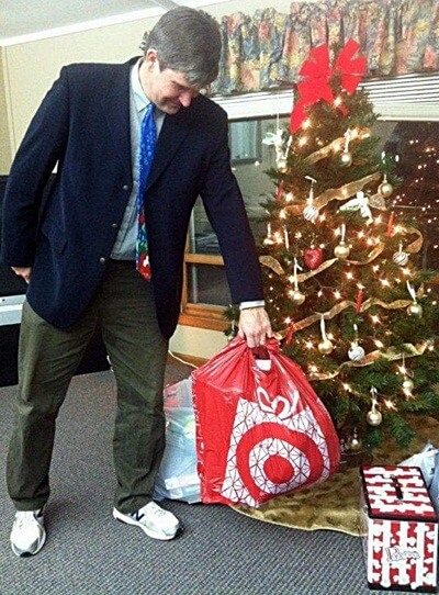 Communication professor David Henningsen drops off gifts for foster children at the Lutheran Child and Family Services office in Belvidere.